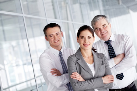 A business team with pretty leader in front looking at camera and smiling Stock Photo - 9725258