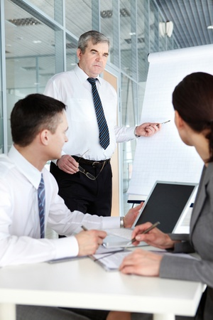 Two businesspeople listening to a teacher at the seminar Stock Photo - 9725217