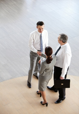business partner: Image of business partners handshaking after signing contract