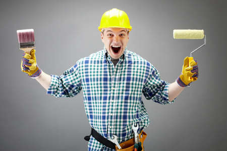 Portrait of crazy painter with paintbrush and roller Stock Photo - 9725238