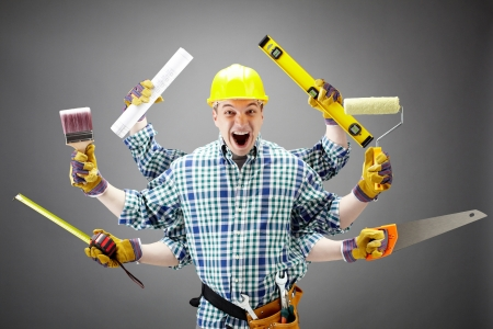 Portrait of shouting craftsman with different tools in six hands Stock Photo - 9725358