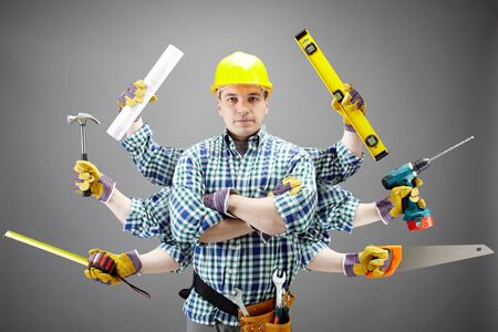repairs: Portrait of serious craftsman with different tools in six hands Stock Photo