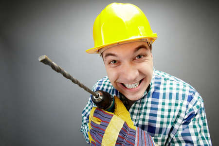 Portrait of smiling architect with electric drill photo