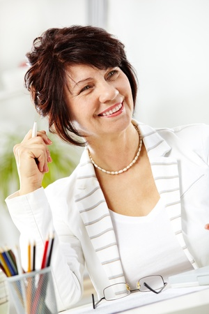 Portrait of middle-aged female looking aside during working day Stock Photo - 9725523