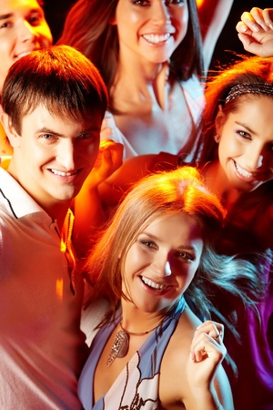 Image of attractive young people having fun at disco photo