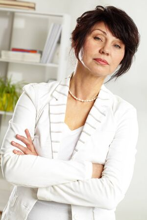 Portrait of confident middle-aged female looking at camera Stock Photo - 9725542
