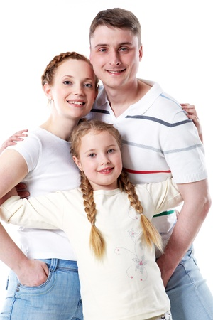 Portrait of happy parents and their daughter in studio photo
