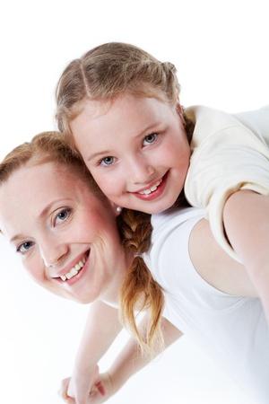 Joyful toddler on back of her mother photo