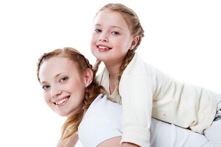 innocent: Joyful toddler on back of her mother