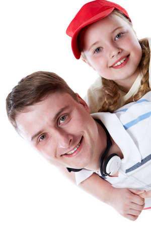 A father holds his cute daughter on back Stock Photo - 9725296