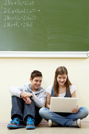 Portrait of guy and girl working with laptop Stock Photo - 9725254