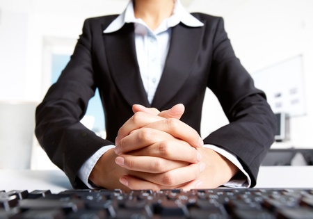 crossed fingers: Photo of secretary with crossed fingers of both hands  Stock Photo