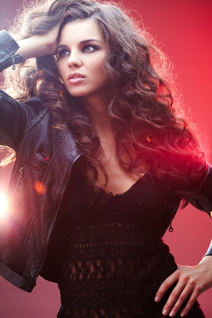 Portrait of a beautiful glamorous brunette in leather jacket photo