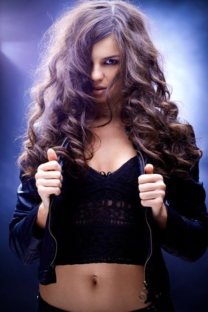 Portrait of a girl with wavy hair against blue background Stock Photo - 9725590