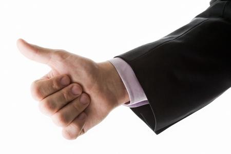 Photo of human hand showing thumb up  photo