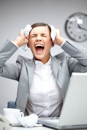Image of young employer touching her head in frustration and crying at workplace Stock Photo - 9725359
