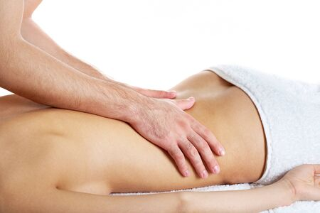 Image of female back being massaged by male hands photo