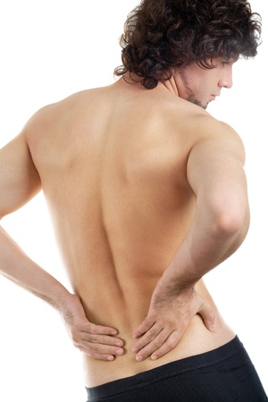 back rub: Back view of young man touching aching back