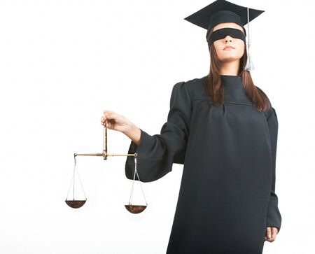 Young lawyer with closed eyes holding scales photo