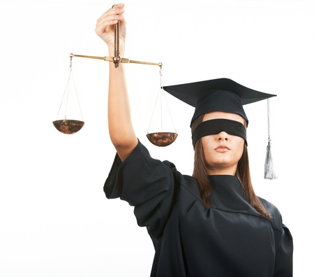 judgement: Young lawyer with closed eyes holding scales Stock Photo