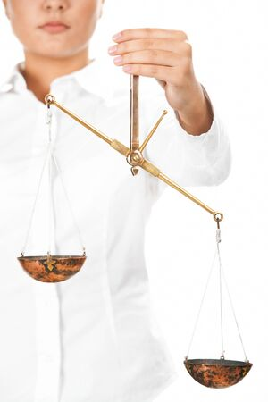 Young judge holding scales in isolation Stock Photo - 9725610