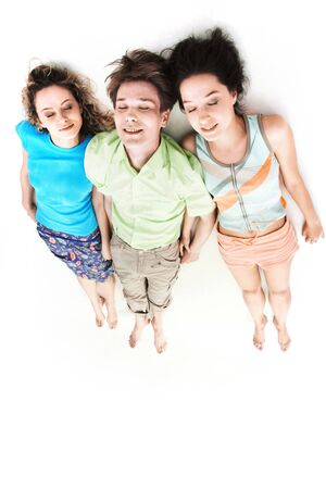 Above view of three barefoot friends lying in isolation Stock Photo - 9725635