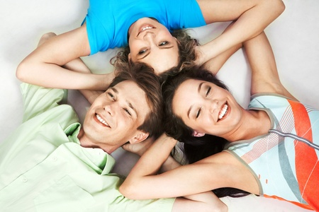 Above view of three happy friends lying head to head Stock Photo - 9725718
