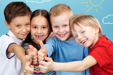 Group of adorable boys and girl showing thumbs up altogether Stock Photo - 9725880