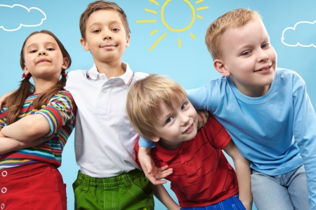 elementary kids: Group of adorable kids looking at camera in creative environment Stock Photo