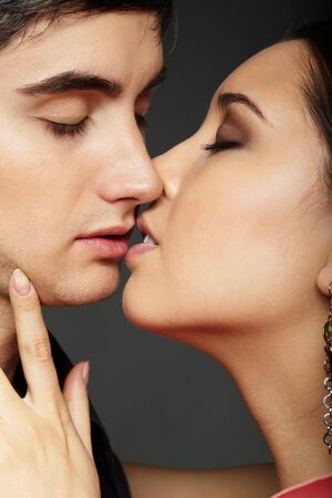 passionate kissing: Portrait of passionate couple on black background