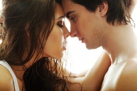 seducing: Portrait of young couple face to face Stock Photo
