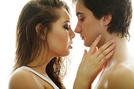 seducing: Pretty brunette and handsome man looking at one another Stock Photo