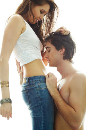 Portrait of young man looking at his girlfriend�s belly while she touching his hair Stock Photo - 9725766