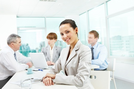 Portrait of smart employer looking at camera in working environment Stock Photo - 9725727