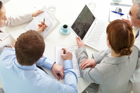 business consulting: Four business people working at meeting