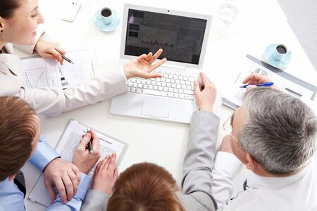 Four business people planning work at meeting Stock Photo - 9725749