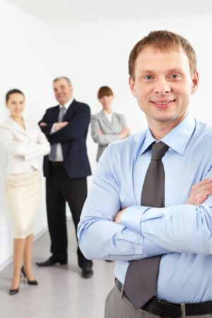 Portrait of confident leader looking at camera with three employees behind Stock Photo - 9725785