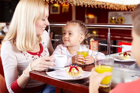 Portrait of cute children and their mother in cafe Stock Photo - 9725814