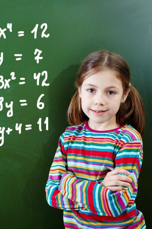 Portrait of pretty girl by the blackboard looking at camera Stock Photo - 9725878