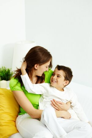 Family of mother and son having good time at home photo