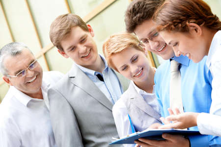 Image of business team looking at paper in male hands at meeting Stock Photo - 9725791