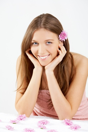 Beautiful girl with pink daisies looking at camera photo