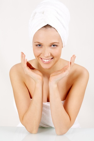 Portrait of clean girl wearing towel on head smiling and looking at camera photo
