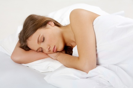 one sheet: Portrait of a young girl sleeping on a pillow