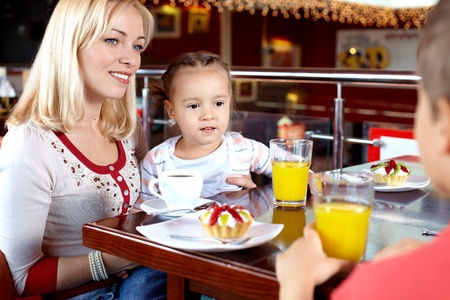 Portrait of happy family having lunch in cafe photo