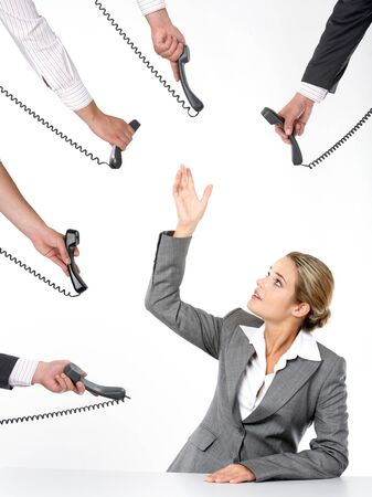 Photo of businesswoman going to take telephone receiver while being offered several of them Stock Photo - 9726373