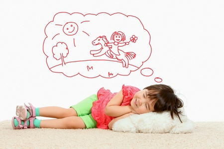 sweet dreams: Portrait of small girl lying and dreaming about riding a horse Stock Photo