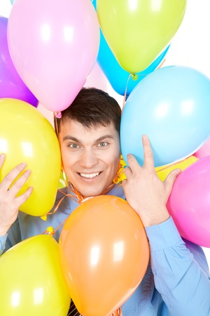 Image of successful businessman face surrounded by multicolored balloons photo