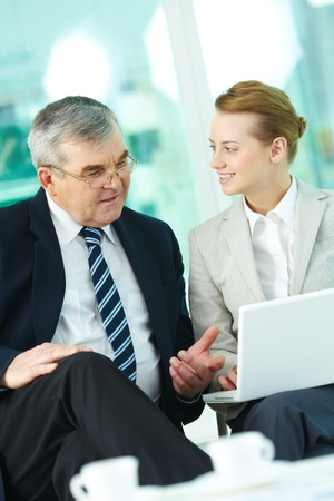 Portrait of boss and employee working with laptop in office Stock Photo - 9726988