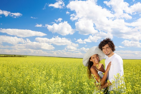 Photo of young couple standing on field and hugging each other while looking at camera Stock Photo - 9726956